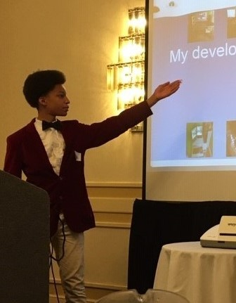 Student Kevin, pictured here giving a presentation at a TPS Collaborators Event in August